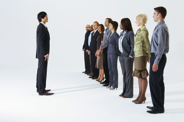 Businessman talking to team